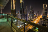 Dubai skyline during night with amazing city center lights and heavy road traffic,UAE. - 209594604