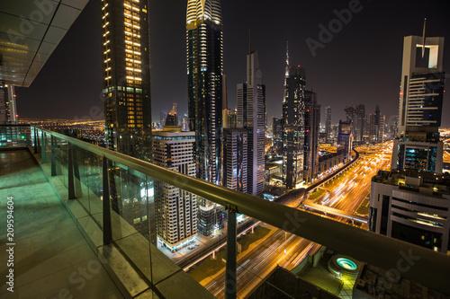 Dubai skyline during night with amazing city center lights and heavy road traffic,UAE.