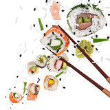 Pieces of delicious japanese sushi frozen in the air. - 209595621