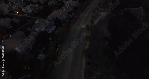 Single Car Overhead Shot Driving Through Frame at Night