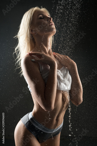 Beautiful sexy blonde having shower in the dark