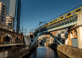 Tokyo train crossing a bridge over the Kanda river near Akihabara. - 209597643