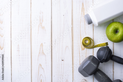 Plexiglas Fitness Fitness equipment and Health food on white wooden background