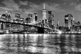 New York City, financial district in lower Manhattan with Brooklin Bridge at night, USA. BW © Bumble Dee