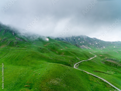 Fotobehang Groene Amazing aerial view at road in the mountain.Road through hills
