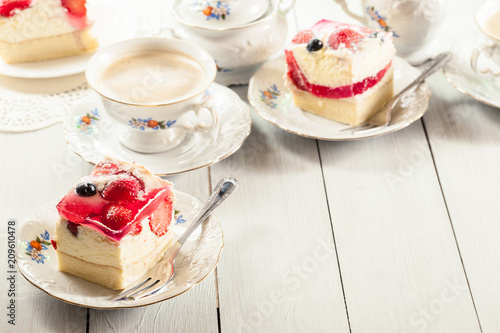 Fototapeta Cheesecake with strawberries, blueberry and jelly