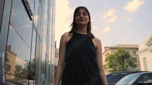Wall mural Happy girl walking in city enjoying summer day