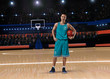 basketball player standing on basketball court