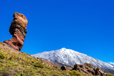 Amazing view of unique Roque Cinchado rock formation with famous Pico del Teide in the background on a sunny day, Teide National Park, Tenerife, Canary Islands, Spain - 209618044