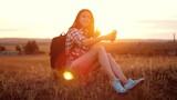 Hipster hiker silhouette girl traveler rest rest slow motion video with backpack. student doing take selfie self-portrait travel the blog the girl recreation park social media lifestyle internet - 209618876
