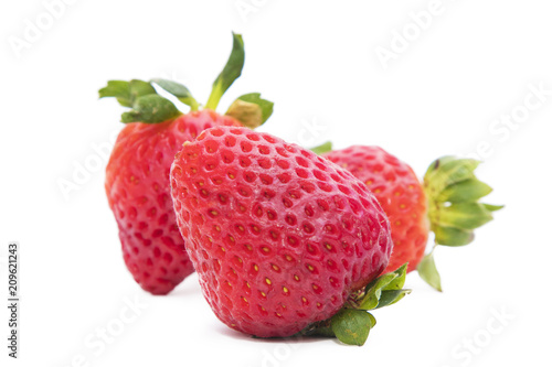 Foto Murales red strawberries isolated in white background