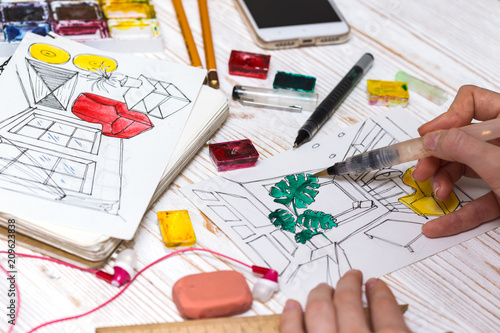 designer makes a sketch of the interior