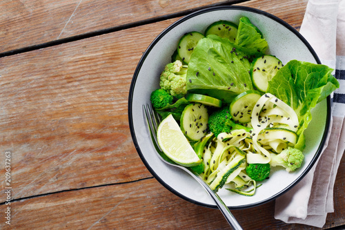 Foto Murales Bowl green salad with copy space top view