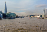 View on London and Thames from Tower Bridge, with Shard, 20 Fenchurch Street and several boats in the water.