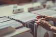 Leinwanddruck Bild - Women's hands browsing vinyl records
