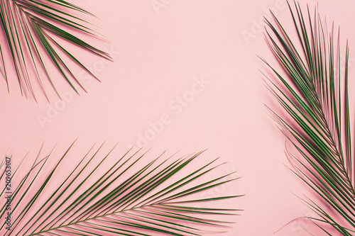 Foto Murales Tropical flat lay with palm leaves