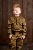children are dressed as soldier in retro military uniforms - 209655856