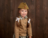 child girl are dressed as soldier in retro military uniforms - 209656251