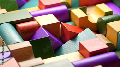 Multicolored wooden blocks toy laid down in the endless pattern. Preschool game. © Dabarti