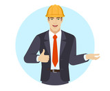 Businessman in construction helmet gesticulating and showing thumb up