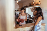 Woman entrepreneur taking orders at her restaurant - 209665694