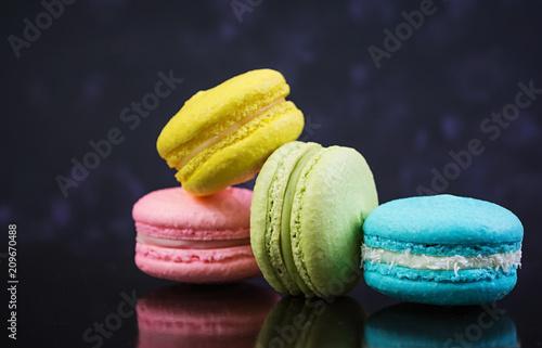 Fotobehang Macarons Delicious colorful macaron cakes on dark background