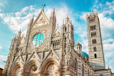 Beautiful marble facade of old landmark of Siena Cathedral (Duomo di Siena catholic church) in Siena, Tuscany, Italy. - 209671001