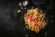 Dark plate with italian spaghetti on dark - 209673063