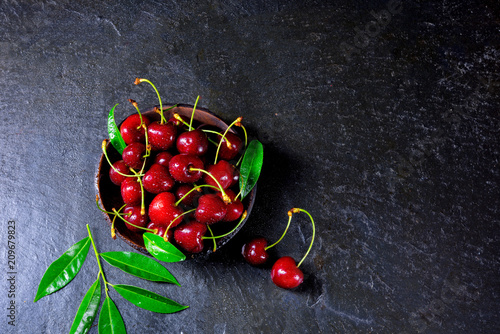 Foto Murales freshly picked cherry in a wooden bowl