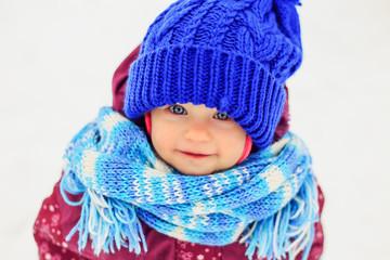 Funny little girl in winter park.