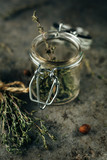 Spice jars with thyme. - 209695035