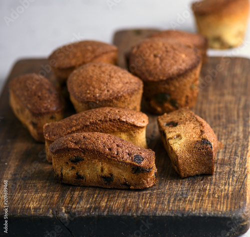 Foto Murales small  baked cupcakes with dry fruits