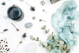 Festive holiday composition with space for text of blue blanket, flowerpot, flowers and eucalyptus branches on white background. Flat lay, top view wedding concept. - 209707615