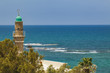 The minaret of the old mosque in the city of Jaffa Tel Aviv against the sea