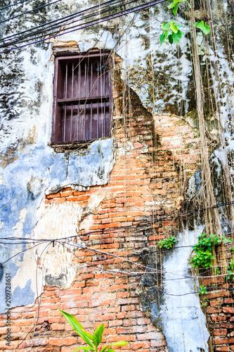 Foto Murales Exposed brickwork on old house