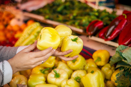 Close-up of female hands holding paprika.