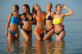 Five laughing women in sea