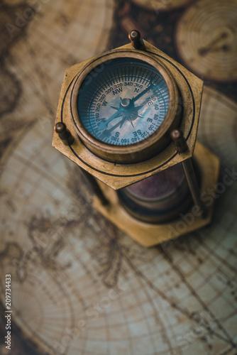 Fototapeta Compass Hourglass On Map