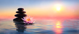 Zen Concept - Spa Stones And Waterlily In Lake At Sunset  - 209737801