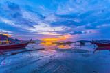 sweet sunrise above fishing boats in Rawai sea during high tide - 209744282