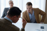 pensive business men sitting at a board meeting thinking over some problem or situation. thought process - 209759433
