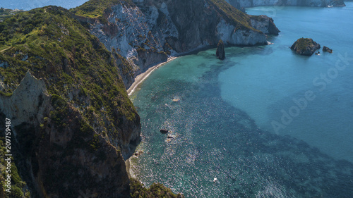 Fotobehang Blauwe jeans Aerial view of Frontone beach in Ponza, in Italy. This is a small bay of an island overlooking the Mediterranean Sea. The beach is full of people.