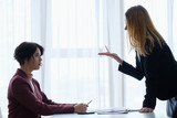boss reproaching her employee. business woman getting a reprimand or reproof chief manager. superior and subordinate professional relationship. - 209759603
