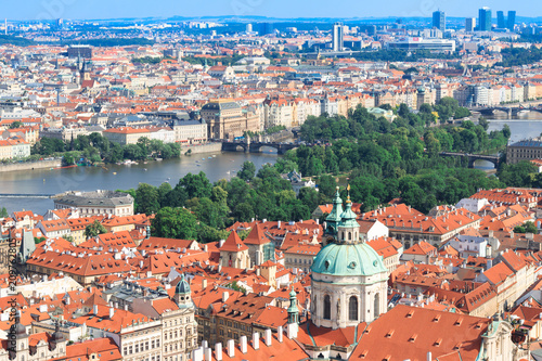 Foto Murales Beautiful and ancient city of Europe - Prague, Czech Republic. View of the city from the observation deck. Small houses and the river Vltava. Charles Bridge and temples.