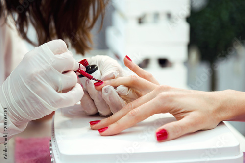 Aluminium Manicure Young woman doing manicure in salon. Beauty concept.