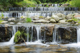 waterfall on a mountain river in the forest 9