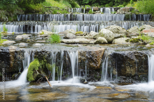 waterfall on a mountain river in the forest 9 - 209772611