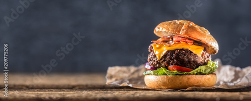 Close-up home made beef burger on wooden table - 209775206