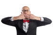 Slim bald elegant nerd in black suit with bow tie gesturing Speak No Evil. Isolated on white.