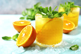 Cold summer orange lemonade with mint and ice cubes. - 209788832